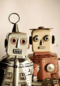 stock photo of tin man  - two retro robot toys - JPG