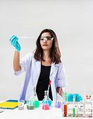 The Chemist In Protective Eyeglasses Working By Test Tube With Reagent In Lab,she Is Checking Testin poster