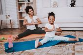 Mom With Young Girl Work And Twine. Happy Day With Mother. Dumbbells With Little Girl. Yoga With Hep poster