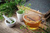 Herbal Tea Cup, Bunch Of Shepherds Purse, Mortar Of Bursa Pastoris Medicinal Herbs And Old Book. Her poster