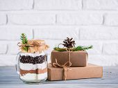 Hot Chocolate Mix In Mason Jar And Rustic Gift Boxes On Gray Table And White Brick Wall. Christmas A poster