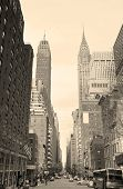 New York City Manhattan street view with Chrysler Building skyscrapers and busy traffic black and wh