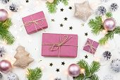 Christmas Background With Fir Tree Branches, Purple Giftboxes, Christmas Lights, Pink Decorations, S poster