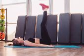 The Girl Is Training In Fitness Gym. Concept Of A Healthy Lifestyle And Exercise In The Gym. The Gir poster