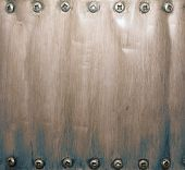 Brown and blue grunge metal background with screws