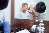 Asian Father Teaching Kid Teeth Brushing, Cute Little 18 Months / 1 Year Old Toddler Boy Child Brush poster