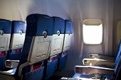 stock photo of cabin crew  - Airplane seat and window inside an aircraft focus on first seat in row - JPG