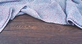 Banner Empty Space On The Desktop. Old Natural Wooden Shabby Background Knitted Blanket Plaid Purple poster
