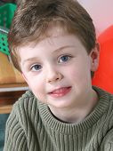 Four year old boy with big blue eyes.