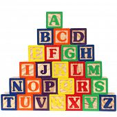 Close-up of ABC blocks A-Z on white background.
