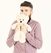 Guy With Beard Hugs Soft Toy With Tenderness. poster