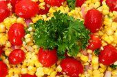 Grilled Corn Salad background.  Tomato, corn, parsley, onion.