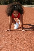 Adorable five year old African American Girl on school track.