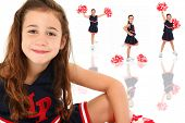Adorable six year old french euro-american girl cheerleader over white.