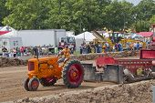 Orange Minneapolis Moline Tractor Pulling Tracks