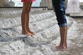 Youth Pair's Legs In Water Cascade