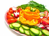 Fresh Vegetables On A Plate On White