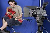 Câmera tiro o Guitarman