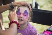 Young Girls Getting Her Face Painted