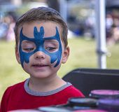 Young Boy Getting Batman Face Paint
