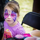 Young Girl With Butterfly Face Paint