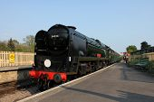 Steam Train arriving at Corfe Castle Railway Station, UK