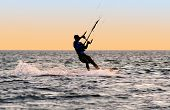 Silhouette Of A Kitesurfer On Waves Of A Gulf