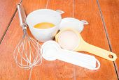 Step Of Bakery Preparation With Milk, Butter, Spoon, Hand Mixer And Yolk Separator