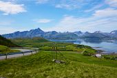 stock photo of lofoten  - Hairpin curve with scenic panorama of norwegian Lofoten islands in the background - JPG