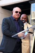 LOS ANGELES - MAY 13:  Dr. Phil McGraw, Steve Harvey at the Steve Harvey Hollywood Walk of Fame Star