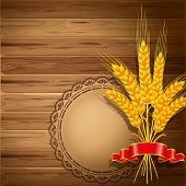 Spikes of wheat on the wooden background