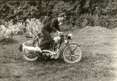 Vintage photo of man on motorbike (1938)
