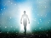 stock photo of cosmos  - Figure emerges from the comos - JPG