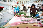 MOSCOW - SEPTEMBER 4: Women make bouquets for XIX International Flower Show in Gostinnyj dvor, on Se