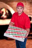 Boy Delivering A Pizza Box
