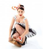 Pinup girl with suitcase in dress spotted, full length retro portrait of young happy sexy woman in pin-up style, vintage stylization over white