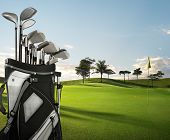 picture of golf bag  - golf equipment on green and hole as background - JPG