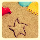 image of a starfish-shaped mark in the sand, and shovels and rakes of different colors, with a retro