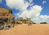 A wide angle view of one of the beaches at Tenby, West Wales, with St Catherine's island on the righ