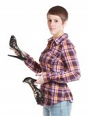 Woman Holding A Pair Of Shoes