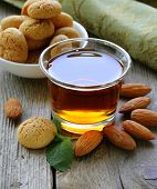 Dessert liqueur Amaretto with almond biscuits (amarittini) and nuts