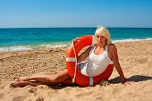 picture of lifeline  - Beautiful slim girl on the beach with a lifeline