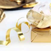 Pretty Gold Wrapped Gift And Twirled Ribbon