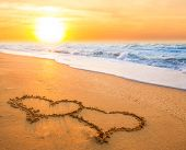 two hearts on beach sand