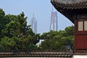 A View Of Jin Mao Tower And Shanghai World Financial Center (in Construction) From Yuyuan Gardens In