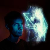 foto of hallucinations  - A man staring at an abstract geometric cloud - JPG
