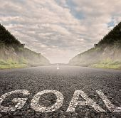 goal word painted on asphalt road