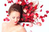 Girl In Petals Of Red Roses
