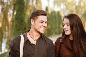 Young Couple Walking Outdoors