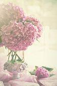 Vase of hydrangeas in the window